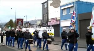 Marchers outside the Ardoyne shops on Saturday