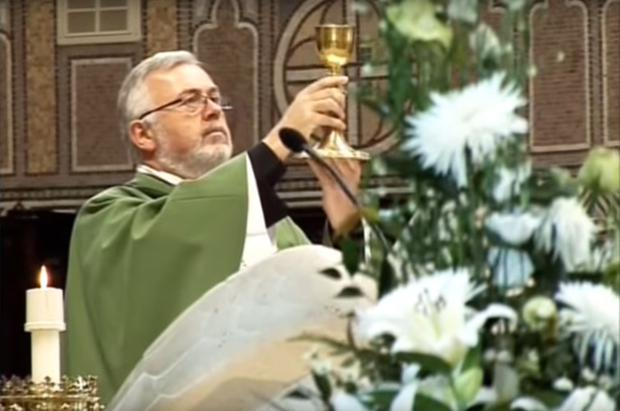 Fr Hugh Kennedy celebrating mass in the BBC documentary.