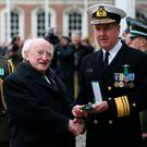President Michael D. Higgins (left) presents Chief of Staff Vice Admiral Mark Mellett with a 1916 Centenary Commemorative Medal at special ceremony at Dublin Castle. PRESS ASSOCIATION Photo. Picture date: Sunday December 4, 2016. Photo credit should read: Brian Lawless/PA Wire