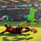 Liverpool's Sadio Mane (right) and AFC Bournemouth's Adam Smith (left) battle for the ball during the Premier League match at the Vitality Stadium, Bournemouth. PRESS ASSOCIATION Photo. Picture date: Sunday December 4, 2016. See PA story SOCCER Bournemouth. Photo credit should read: Adam Davy/PA Wire. RESTRICTIONS: EDITORIAL USE ONLY No use with unauthorised audio, video, data, fixture lists, club/league logos or