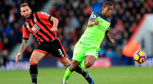 Liverpool's Georginio Wijnaldum (right) and AFC Bournemouth's Steve Cook (left) battle for the ball during the Premier League match at the Vitality Stadium, Bournemouth. PRESS ASSOCIATION Photo. Picture date: Sunday December 4, 2016. See PA story SOCCER Bournemouth. Photo credit should read: Adam Davy/PA Wire. RESTRICTIONS: EDITORIAL USE ONLY No use with unauthorised audio, video, data, fixture lists, club/league logos or