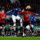 Everton's Ramiro Funes Mori (left) and Manchester United's Marcos Rojo (right) battle for the ball during the Premier League match at Goodison Park, Liverpool. PRESS ASSOCIATION Photo. Picture date: Sunday December 4, 2016. See PA story SOCCER Everton. Photo credit should read: Peter Byrne/PA Wire. RESTRICTIONS: EDITORIAL USE ONLY No use with unauthorised audio, video, data, fixture lists, club/league logos or