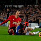 Manchester United's Zlatan Ibrahimovic (right) and Everton's Seamus Coleman (left) take a tumble during the Premier League match at Goodison Park, Liverpool. PRESS ASSOCIATION Photo. Picture date: Sunday December 4, 2016. See PA story SOCCER Everton. Photo credit should read: Peter Byrne/PA Wire. RESTRICTIONS: EDITORIAL USE ONLY No use with unauthorised audio, video, data, fixture lists, club/league logos or