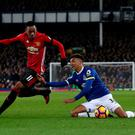 Manchester United's Anthony Martial (left) and Everton's Mason Holgate (right) battle for the ball during the Premier League match at Goodison Park, Liverpool. PRESS ASSOCIATION Photo. Picture date: Sunday December 4, 2016. See PA story SOCCER Everton. Photo credit should read: Peter Byrne/PA Wire. RESTRICTIONS: EDITORIAL USE ONLY No use with unauthorised audio, video, data, fixture lists, club/league logos or
