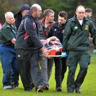 Best of care: Injured Mark Best is taken to hospital