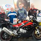 Speed read: (from left) Eddie Johnston, Dundrod & District Motorcycle Club, Andy Higgins, event compere, race ace Ian Hutchinson and Ken Stewart, Dundrod & District Motorcycle Club, pictured at Hutchinson book signing at Charles Hurst BMW Motorrad