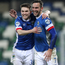 All smiles: Andy Waterworth enjoys his second goal with Paul Smyth