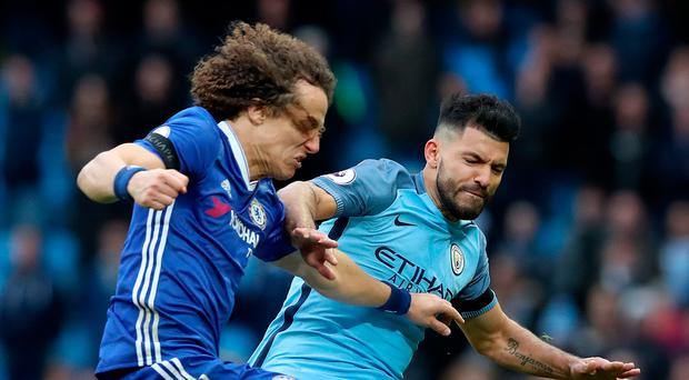 Kicking off: Manchester City striker Sergio Aguero's tackle on David Luiz sparked a melee