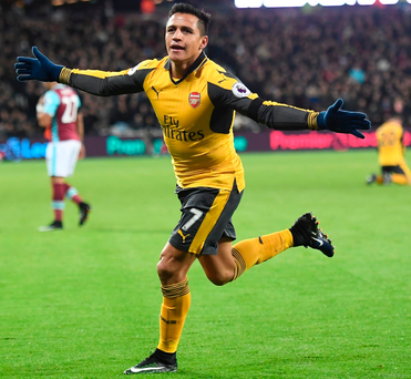 Hit man: Alexis Sanchez celebrates scoring against West Ham