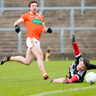 Net gain: Armagh's Aiden Forker scores past Derry keeper Ben McKinless