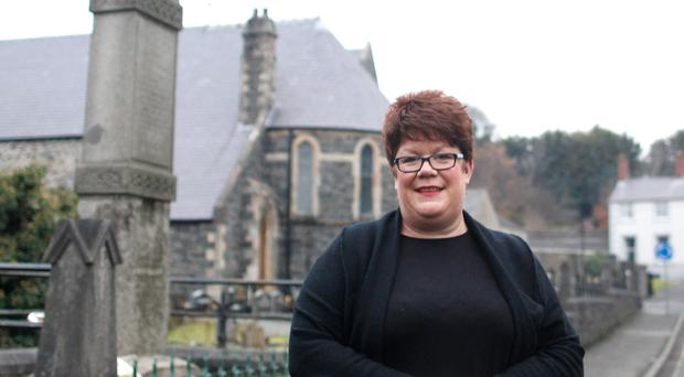 At peace: Jenni Spice outside her church