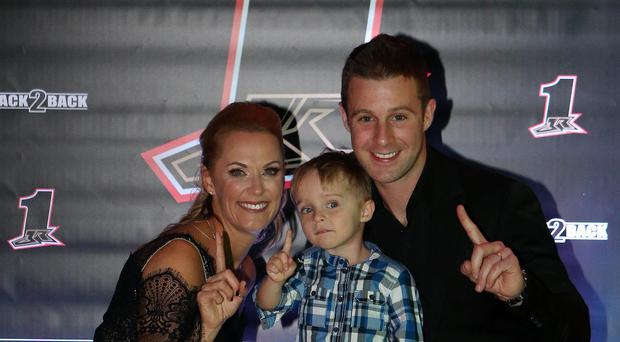 Double World Superbike champion Jonathan Rea from Ballyclare celebrates his success at the Culloden Hotel last night with his wife Tatia and son Jake