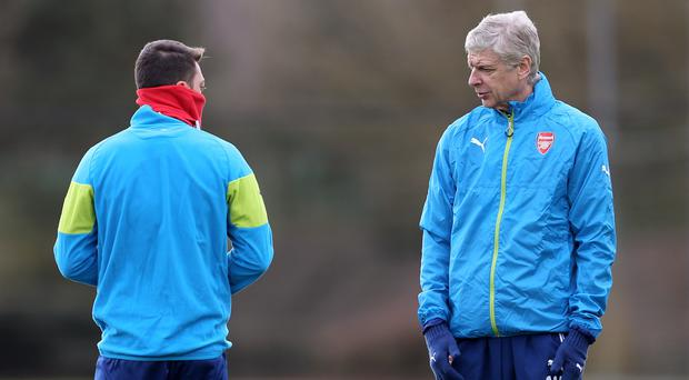 Talk tactics: Arsene Wenger has a word with Mesut Ozil