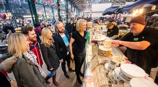 Tasting and sampling at St Georges Markets. Tourism NI