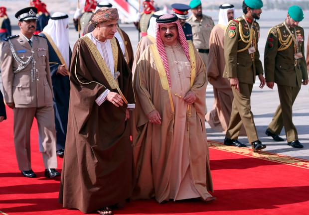 King of Bahrain, Hamad bin Issa al-Khalifa (R) welcomes the Oman's Foreign Minister Yusuf bin Alawi (L) upon his arrival for the 37th on December 6, 2016 in the Bahraini capital Manama. British Prime Minister Theresa May was to join Gulf Arab leaders at a summit in Bahrain for talks on trade after Britain's exit from the European Union. / AFP PHOTO / STRINGERSTRINGER/AFP/Getty Images