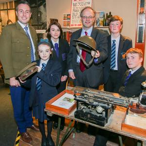 Communities Minister Paul Givan and Education Minister Peter Weir with Joshua Russell and Christina Edgar of Movilla High School, and Lucas McDowell and Morgan Brown of Bangor Academy, at the launch of the initiative in the Somme Heritage Centre.