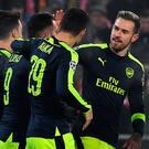 Arsenal's players celebrate after Arsenal's Spanish forward Lucas Perez (3rdL) scored a goal during the UEFA Champions league Group A football match between FC Basel 1893 and Arsenal FC on December 6, 2016 at the St Jakob Park stadium in Basel. / AFP PHOTO / Patrick HERTZOGPATRICK HERTZOG/AFP/Getty Images