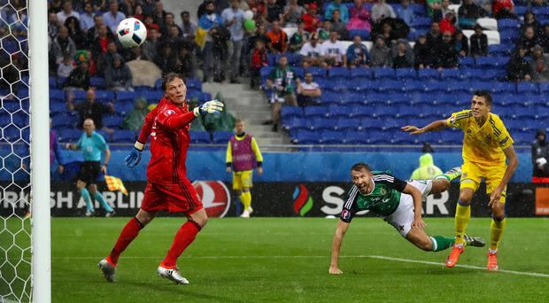 Heads we win: Gareth McAuley heads Northern Ireland on the way to a 2-0 victory over Ukraine in Lyon