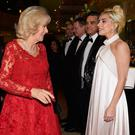 The Duchess of Cornwall greets British singer Lady Gaga during the Royal Variety Performance at the Hammersmith Apollo in London last night.
