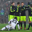 (From L- top) Arsenal's Spanish forward Lucas Perez celebrates after scoring a goal with his teammates Arsenal's English defender Kieran Gibbs, Arsenal's German midfielder Mesut Ozil and Arsenal's Chilean forward Alexis Sanchez, next to Basel's Colombian defender Eder Balanta during the UEFA Champions league Group A football match between FC Basel 1893 and Arsenal FC on December 6, 2016 at the St Jakob Park stadium in Basel. / AFP PHOTO / Patrick HERTZOGPATRICK HERTZOG/AFP/Getty Images