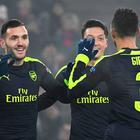 Arsenal's Spanish forward Lucas Perez (L) celebrates with his teammate Arsenal's German midfielder Mesut Ozil (2ndR) and Arsenal's English defender Kieran Gibbs after scoring a goal during the UEFA Champions league Group A football match between FC Basel 1893 and Arsenal FC on December 6, 2016 at the St Jakob Park stadium in Basel. / AFP PHOTO / Patrick HERTZOGPATRICK HERTZOG/AFP/Getty Images