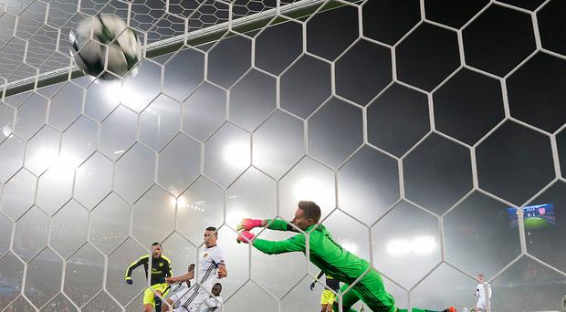 Arsenal's Lucas Perez, left, scores against Basel during their Champions League Group stage Group A soccer match between Switzerland's FC Basel 1893 and England's Arsenal FC in the St. Jakob-Park stadium in Basel, Switzerland, on Tuesday, Dec. 6, 2016. (Georgios Kafalas/Keystone via AP)