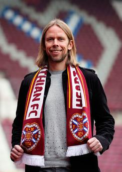 New challenge: Austin MacPhee was unveiled as Hearts assistant boss at Tynecastle yesterday but will remain with Northern Ireland