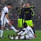 Breakthrough: Lucas Perez celebrates with Mesut Ozil after putting Arsenal in front in Switzerland last night