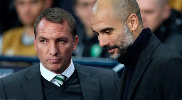 Level: Brendan Rodgers (left) and Pep Guardiola last night