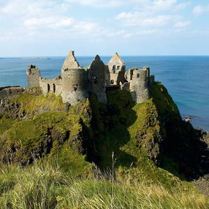 Breathtaking view of the Medieval Dunluce Castle in the North coast of County Antrim. Northern Ireland Tourist Board