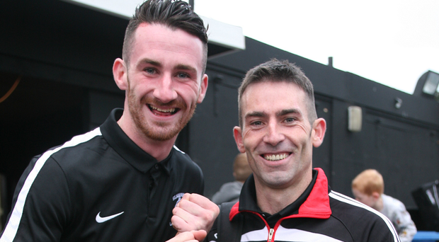 London calling: Mark Mulholland and Ciaran Carville celebrate St Kiernan's first ever London Championship title triumph