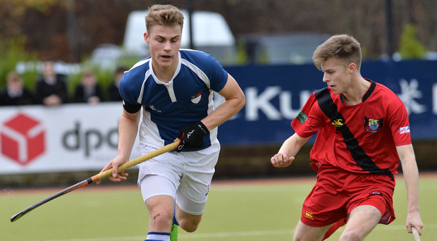 Surging forward: Royal & Prior captain Alex Tinney (left) takes on Banbridge's Mark Barlow in the McCullough Cup final