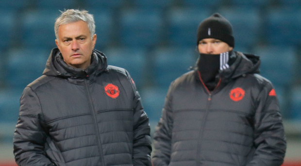 Cold front: Jose Mourinho at last night's United training session in Odessa