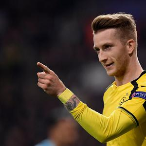 Dortmund's midfielder Marco Reus celebrates a goal during the UEFA Champions League football match Real Madrid CF vs Borussia Dortmund at the Santiago Bernabeu stadium in Madrid on December 7, 2016. / AFP PHOTO / JAVIER SORIANOJAVIER SORIANO/AFP/Getty Images