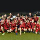 Champions: the victorious Banbridge Academy team celebrate with the McCullough Cup. Photo: Rowland White PressEye