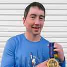 Ryan McCaul after running the New York Marathon to raise funds for the fight against cancer