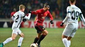 Zorya Luhansk's Serbian midfielder Zeljko Ljubenovic (L) vies for the ball with Manchester United's Swedish forward Zlatan Ibrahimovic (R) during the UEFA Europa League football match between FC Zorya Luhansk and Manchester United FC at the Chornomorets stadium in Odessa on December 8, 2016. AFP/Getty Images