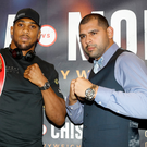 Raring to go: Anthony Joshua (left) and Eric Molina square up ahead of tomorrow night's World title fight in Manchester