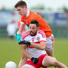 Soaring starlet: Midfield ace Ben Crealey (rear) can bolster Armagh's hopes of success