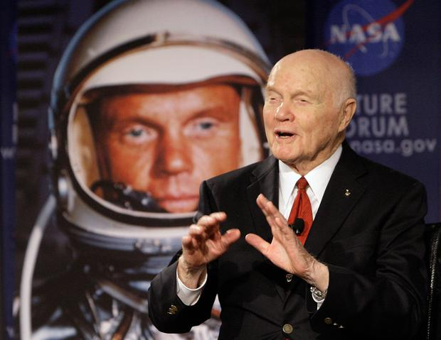 FILE - In this Feb. 20, 2012, file photo, U.S. Sen. John Glenn talks with astronauts on the International Space Station via satellite before a discussion titled