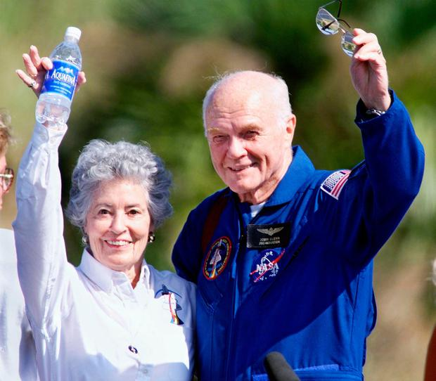 Astronaut John Glenn (R) and his wife Annie wave to friends at the Kennedy Space Center, FL 08 November as the crew of the Shuttle Discovery prepared to fly to Johnson Space Center in Houston. (Photo: Tony RanzeAFP/Getty Images)