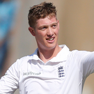 England's batsman Keaton Jennings raises his bat after scoring century in Mumbai