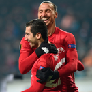 All smiles: Zlatan Ibrahimovic hails Henrikh Mkhitaryan after the latter's opening goal