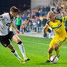 Eyes on the prize: Maccabi Tel Aviv forward Tal Ben Chaim vies for the ball against Dundalk's Sean Gannon