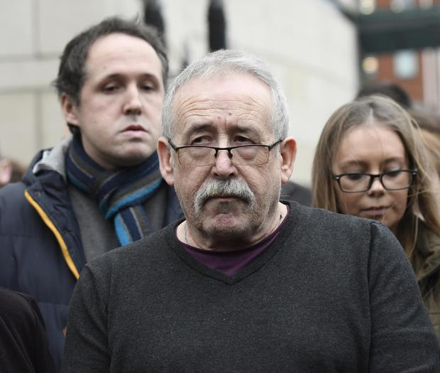 Father Jim Creaney (right) reads a statement to the media , as family and friends of murdered man Owen Creaney leave Laganside Court on Friday, after Stephen Thomas Hughes and Shaunean Boyle were sentenced for murdering Owen Creaney at Moyraverty Court, Craigavon, in July 2014. The pair had been convicted of murder and dumping his body in a bin. Photo Colm Lenaghan/Pacemaker Press