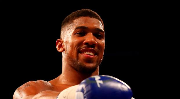 Anthony Joshua (pictured) has teamed back up with former GB Boxing mentor Rob McCracken ahead of the second defence of his IBF heavyweight title against Eric Molina in Manchester tonight