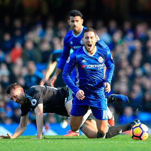 West Bromwich Albion's Jonas Olsson (left) and Chelsea's Eden Hazard battle for the ball during the Premier League match at Stamford Bridge, London. Press Association