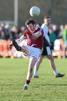 Kicking on: Slaughtneil's Paul Bradley launches an attack