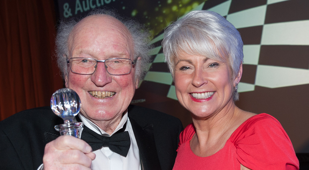 Glass act: Esler Crawford accepts his Outstanding Services to Motorsport award from event organising committee leading lady and compere, Pamela Ballantine
