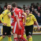 Slanging match: Jason McGuinness continues his war of words with Portadown's Garry Breen after the sending off that also saw Reds winger Ross Lavery depart the game early
